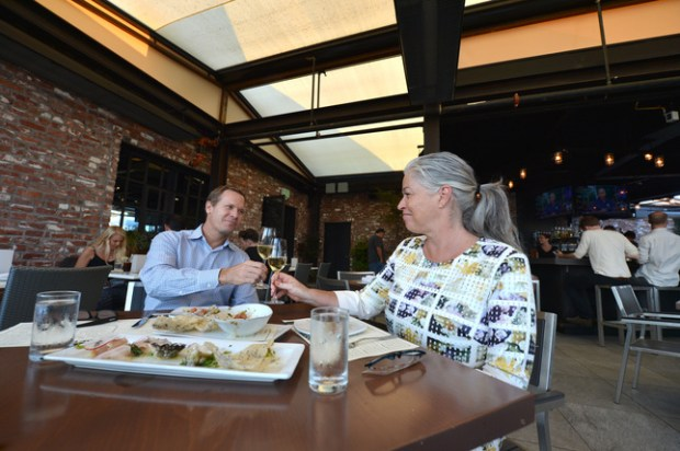 Karen and Scott Pope, of Walnut Creek, enjoy the open air ambience in the dining room of the recently-opened Rooftop Restaurant and Bar in Walnut Creek, Calif., on Monday, August 22, 2016. (Kristopher Skinner/Bay Area News Group)