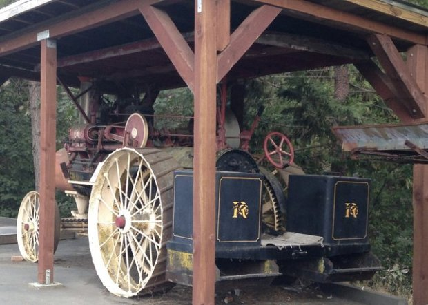 At the Buffalo Hill Outdoor Museum, vintage vehicles, such as this 1921 Russell steam tractor and an 1880 Rubicon Flyer, take center stage in a shopping center parking lot. (Photo: Jackie Burrell/Bay Area News Group)