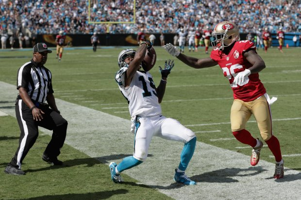 Ted Ginn #19 of the Carolina Panthers tries to maintain possession against Tramaine Brock #26 of the San Francisco 49ers as they go out of bounds in the 3rd quarter during their game at Bank of America Stadium on September 18, 2016 in Charlotte, North Carolina. (Photo by Streeter Lecka/Getty Images)