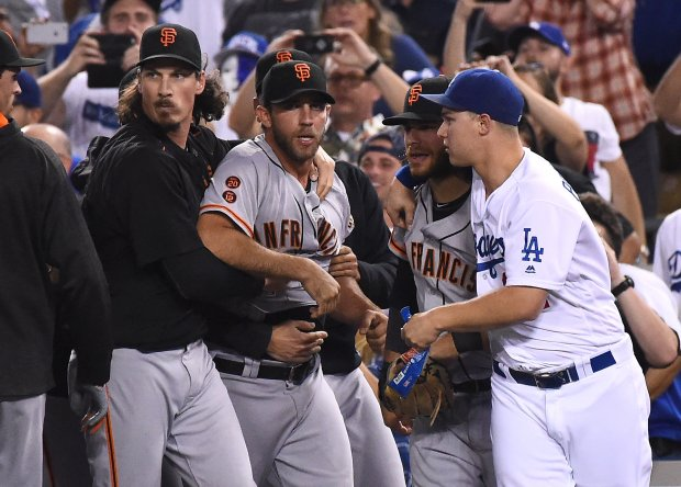 LOS ANGELES, CA - SEPTEMBER 19: Jeff Samardzija #29 of the San Francisco Giants holds back Madison Bumgarner #40 of the San Francisco Giants as Joc Pederson #31 of the Los Angeles Dodgers holds back Brandon Crawford #35 of the San Francisco Giants after benches cleared after the final out of the seventh inning of the game at Dodger Stadium on September 19, 2016 in Los Angeles, California. (Photo by Jayne Kamin-Oncea/Getty Images)