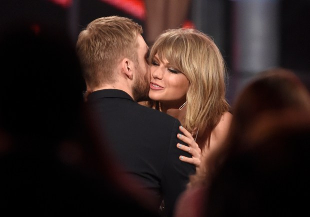 "Taylor Swift, right, hugs Calvin Harris after winning the award for top billboard 200 album for ""1989"" at the Billboard Music Awards at the MGM Grand Garden Arena on Sunday, May 17, 2015, in Las Vegas. (Photo by Chris Pizzello/Invision/AP)"