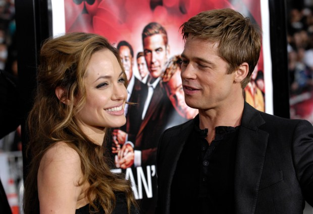 "FILE - In this June 5, 2007 file photo, Angelina Jolie and Brad Pitt arrive at the premiere of ""Ocean's Thirteen"" in Los Angeles, Calif. Angelina Jolie Pitt has filed for divorce from Brad Pitt, bringing an end to one of the world's most star-studded, tabloid-generating romances. An attorney for Jolie Pitt, Robert Offer, said Tuesday, Sept. 20, 2016, that she has filed for the dissolution of the marriage. (AP Photo/Chris Pizzello, File)"