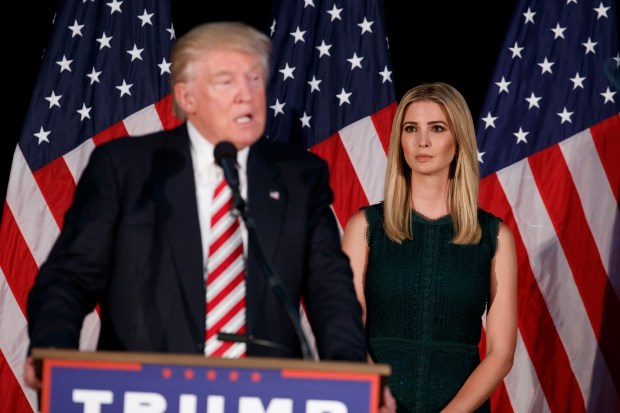 Ivanka Trump, right, looks on as her father, Republican presidential candidate Donald Trump, delivers a policy speech on child care, Tuesday, Sept. 13, 2016, in Aston, Penn. (AP Photo/Evan Vucci)