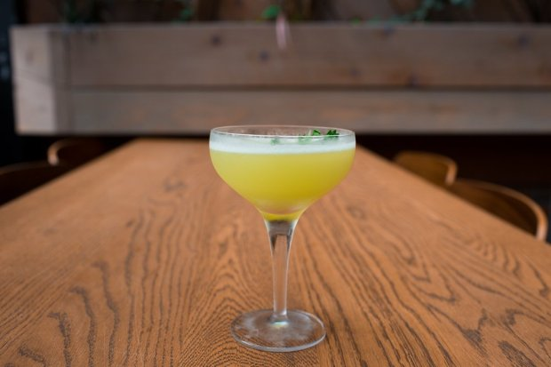 This cocktail, designed by Ian Scalzo from San Francisco's Horsefeather, is made with vodka, fresh lime and a housemade honey, herbs and rose syrup. (Photo credit: Courtesy of Noelle Chun)