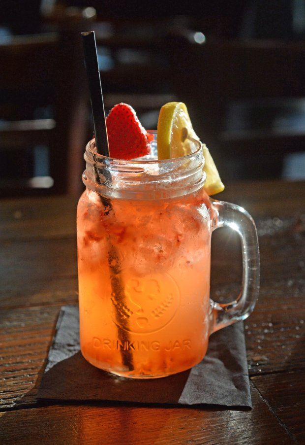 A glass of Pink lemonade moonshine is photographed at the Southern Sweetwater Tavern in Danville, Calif., on Thursday, Sept. 1, 2016. (Doug Duran/Bay Area News Group)