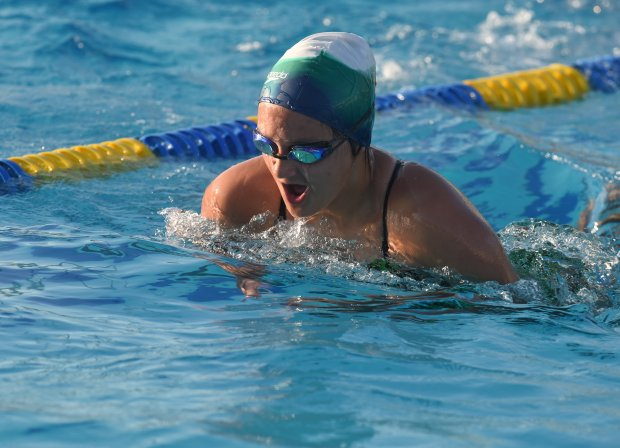 Halia  Zarate, 13, of Oakley,  comes up for air as she swims a lap during practice at Heritage High School with her Seawolves swimming team in Brentwood, Calif., on Tuesday, Sept. 6, 2016. Eight years ago she was pulled from the bottom of an apartment swimming pool not breathing and after receiving CPR came back to life.  (Susan Tripp Pollard/Bay Area News Group)