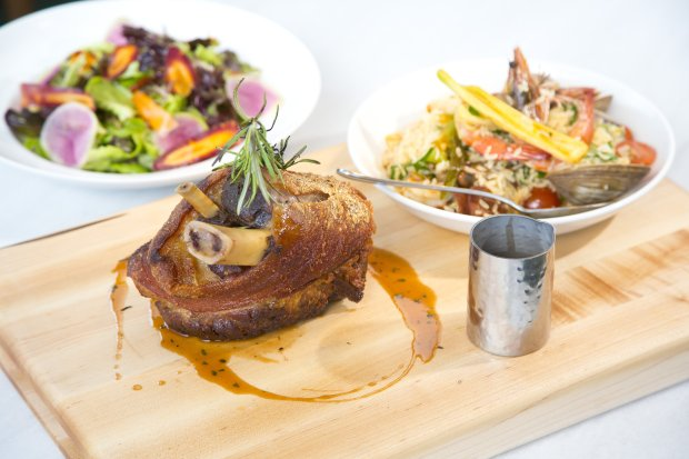 The new BLT Market at the Ritz-Carlton Residences offers thoughtfully prepared dishes that showcase local ingredients, such as this Crackling Shinsato Farm Pork Shank. (Photo courtesy Rae Huo and ESquared Hospitality)