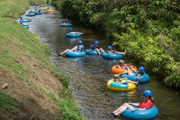 VIsitors can swoop down irrigation canals and through hand-hewn tunnels at Lihue Plantation on Kauai. (Kauai Backcountry Adventures)