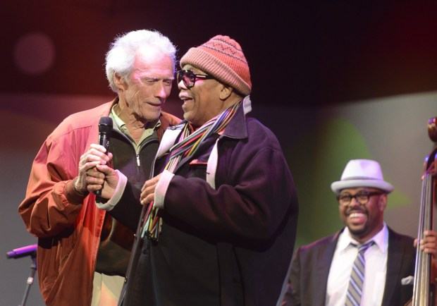 Clint Eastwood jokes with Quincy Jones as bassist Christian McBride looks on during Tribute to Quincy Jones The A&M Years at the 59th annual Monterey Jazz Festival at the Monterey County Fair and Events Center in Monterey, Calif. on Friday September 16, 2016. (David Royal - Monterey Herald)