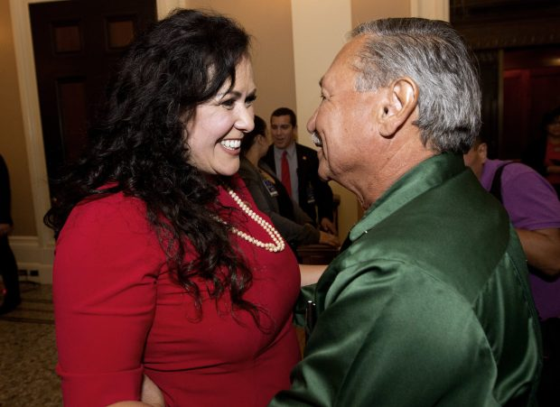 Assemblywoman Lorena Gonzalez, D-San Diego, receives congratulations from Arturo Rodriguez, president of the United Farm Workers, after the Assembly approved her bill requiring farmworkers to receive overtime pay after working eight hours, at the Capitol, in Sacramento, Calif. Calif. Gov. Jerry Brown, signed Gonzalez' bill, AB1066, Monday, Sept. 12, 2016. (AP Photo/Rich Pedroncelli,file)