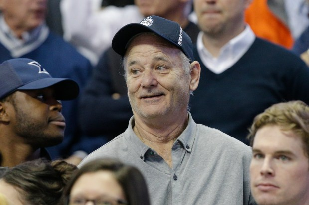 FILE - In this Feb. 28, 2016 file photo, actor Bill Murray attends an NCAA college basketball game between Xavier and Villanova, in Cincinnati. Murray was the first and last guest on David Letterman's late-night show, and Letterman will return the favor by making a rare public appearance when Murray is presented with the nation's top prize for humor. On Tuesday, Se[t. 14, 2016, The Kennedy Center announced the lineup of performers for next month's celebration of Murray, who'll receive the Mark Twain Prize for American Humor. (AP Photo/John Minchillo, File)