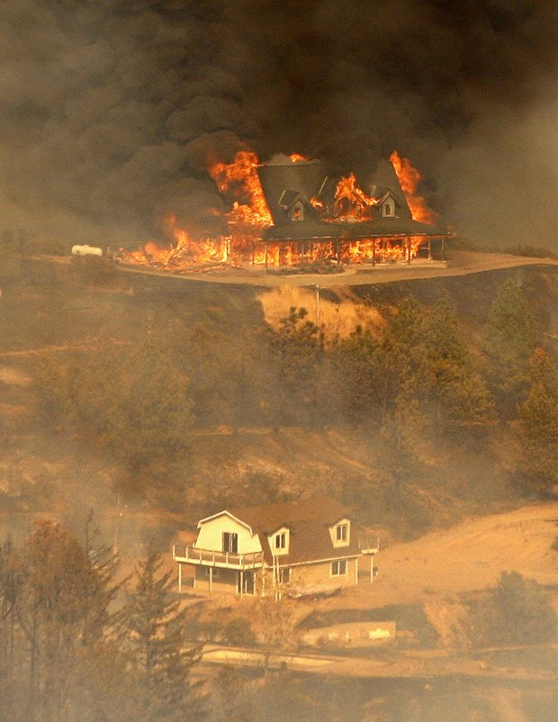 A structure burns in the Loma Fire off Loma Prieta Road and Loma Chiquita Road in Santa Clara County on Monday. (Vern Fisher - Monterey Herald)