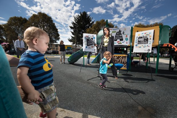 Photo by Paul Kuroda Willie Wilkins Playground, 9700 C Street, Oakland Oakland California. Logan Tucker, 18-months and Melissa Rodriguez, 2, wander as Oakland Mayor Libby Schaaf speaks during the opening event of the new playground.