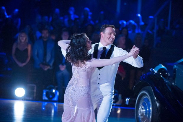 """In this photo provided by ABC, Cheryl Burke, left, and Ryan Lochte, perform on """"Dancing with the Stars."""" (Eric McCandless/ABC via AP)"""