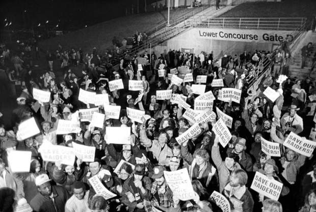In 1981, Raiders fans protest the potential move of team to Los Angeles outside the Oakland Coliseum. (AP Photo)