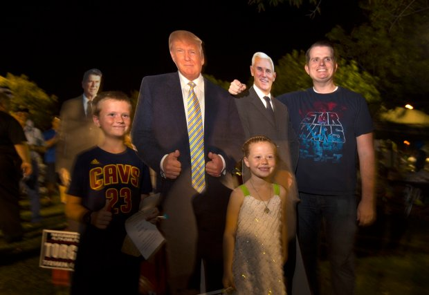 David Hurst, of Gilbert, and his son, Samuel, 9, and daughter, Juliette, 6, pose for a snapshot with cardboard cutouts of, from left, Ronald Reagan, Donald Trump and Mike Pence were on display during a Constitution Fair in Gilbert, Ariz., Saturday, Sept. 17, 2016. From left are: Sandi Bartlett, Angi Stamm and Sylvia Marre. Arizona is a swing state for the first time in many years. The last time Arizona was in play for a Democratic presidential nominee, the candidate was Bill Clinton and the main reason he narrowly carried the state in 1996 was that Republicans defected to Ross Perot. (Patrick Tehan/Bay Area News Group)