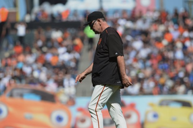 The San Francisco Giants manager Bruce Bochy heads back to the dugout after taking out starting pitcher Madison Bumgarner (40) against the San Diego Padres' in the seventh inning of their MLB game at AT&T Park in San Francisco, Calif., on Wednesday, Sept. 14, 2016. (Dan Honda/Bay Area News Group)