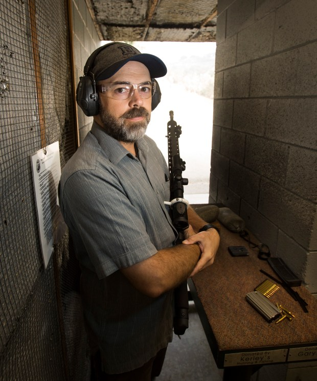 Chuck Rossi does target practice with his AR-15 rifle at a Santa Clara County gun club whose ownership declined to have identified, on Friday, Sept. 30, 2016. Rossi is a competitive shooter and firearms instructor who practices and teaches at the gun club. He is opposed to Prop. 63. (Patrick Tehan/Bay Area News Group)