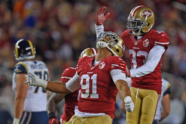 San Francisco 49ers' Arik Armstead (91) is congratulated by teammate Rashard Robinson (33) after sacking Los Angeles Rams' Case Keenum (17) in the second quarter of their NFL game at Levi's Stadium in Santa Clara, Calif., on Monday, Sept. 12, 2016. (Jose Carlos Fajardo/Bay Area News Group)