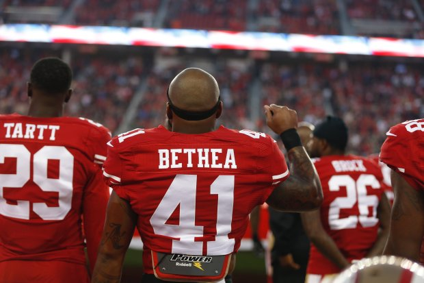 San Francisco 49ers quarterback Antoine Bethea (41) raises his fist af rhe end of the National Anthem before their game against the Los Angeles Rams for their NFL game at Levi's Stadium in Santa Clara, Calif., on Monday, Sept. 12, 2016. (Nhat V. Meyer/Bay Area News Group)
