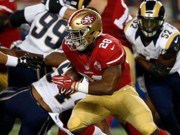 San Francisco 49ers' Carlos Hyde (28) runs with the ball against the Los Angeles Rams in the first quarter of their NFL game at Levi's Stadium in Santa Clara, Calif., on Monday, Sept. 12, 2016. (Nhat V. Meyer/Bay Area News Group)