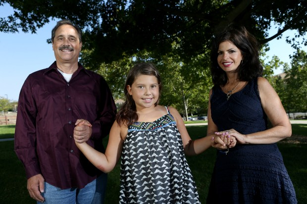 Bob Pack, wife Carmen Pack and daughter Noelle Pack, 10, pose for a photograph in Danville, Calif., on Friday, Aug. 26, 2016. The Packs lost two young children, 7 year-old Alana and 10 year-old Troy, when they were run over by a driver in 2003 who was high on drugs and alcohol. (Anda Chu/Bay Area News Group)