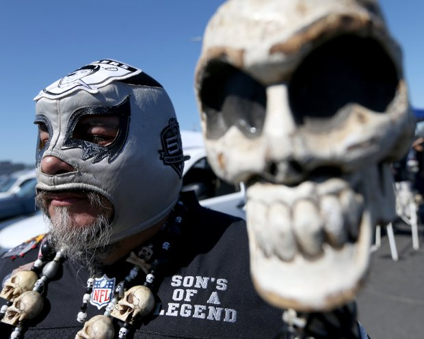 Javier Rivera, of Stockton, poses for a photograph in the parking lot before the start of the Oakland Raiders NFL game against the Atlanta Falcons at the Coliseum in Oakland, Calif., on Sunday, Sept. 18, 2016. (Anda Chu/Bay Area News Group)