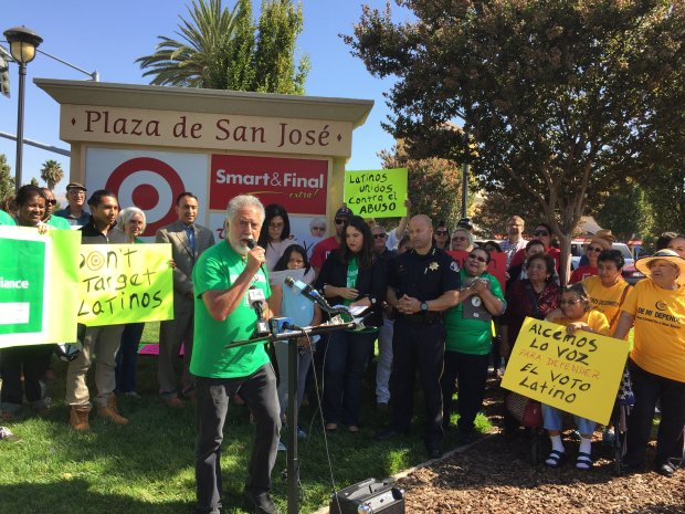 """Salvador """"Chava"""" Bustamante of the Latino Vote Alliance of Silicon Valley, speaks at a rally Sept. 15, 2016 in front of an East San Jose Target store, where he had been arrested on trespassing while registering voters earlier in the week."""