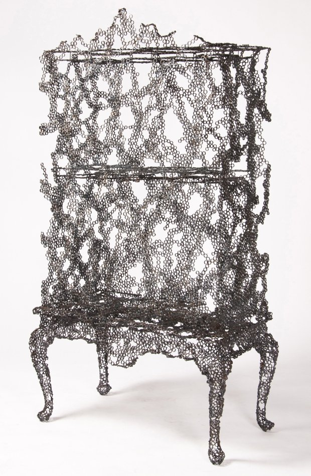 """Finnish designer Tuomas Markunpoika welded steel rings together over an antique-style highboy chest and then burned the chest away to create this cabinet from his Engineering Temporality series (2012), featured in """"Beauty"""" at San Jose Museum of Art. (© Tuomas Markunpoika/Cooper Hewitt)"""