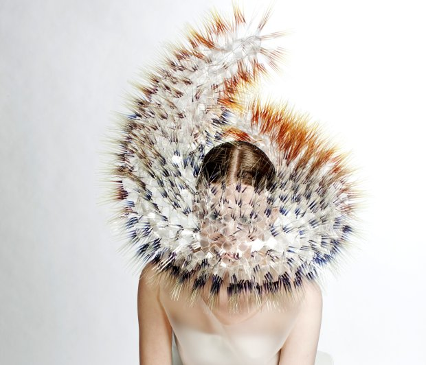 This chapeau from Maiko Takeda's Atmospheric Reentry series incorporates acetate films, acrylic discs, metal jumprings, a plastic base and fabric-covered metal wire. (© Bryan Huynh)