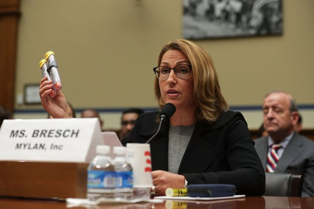 "Mylan Inc. CEO Heather Bresch holds up a 2-pack of EpiPen as she testifies during a hearing before the House Oversight and Government Reform Committee September 21, 2016 on Capitol Hill in Washington, DC. The committee held a hearing on ""Reviewing the Rising Price of EpiPens."" (Photo by Alex Wong/Getty Images)"