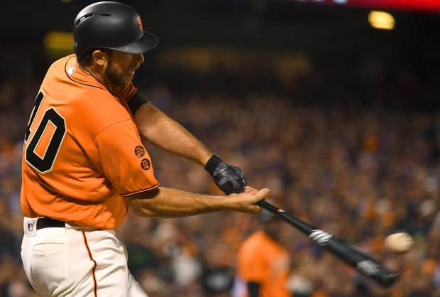 SAN FRANCISCO, CA - SEPTEMBER 30: Pitcher Madison Bumgarner #40 of the San Francisco Giants hits a two-run rbi double against the Los Angeles Dodgers in the bottom of the six inning at AT&T Park on September 30, 2016 in San Francisco, California. (Photo by Thearon W. Henderson/Getty Images)