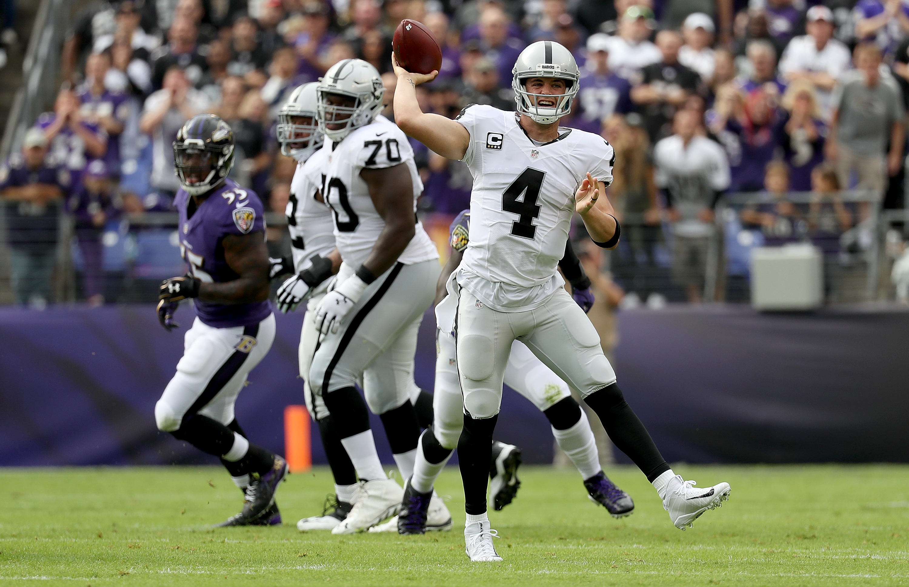 Derek Carr #4 of the Oakland Raiders throws a pass in the first quarter against the Baltimore Ravens at M&T Bank Stadium