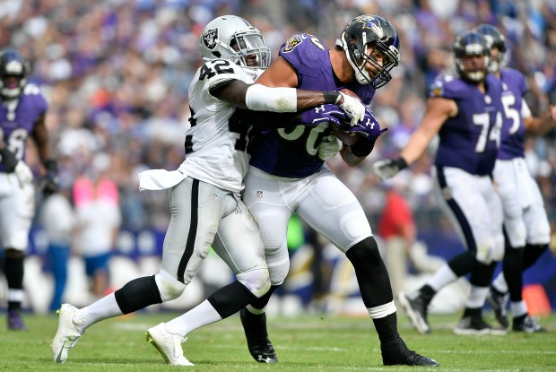 Karl Joseph #42 of the Oakland Raiders tackles Crockett Gillmore #80 of the Baltimore Ravens in the third quarter at M&T Bank Stadium on October 2, 2016 in Baltimore, Maryland. (Photo by Larry French/Getty Images)