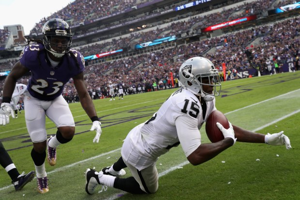 Michael Crabtree #15 of the Oakland Raiders catches a fourth quarter touchdown pass in front of Kendrick Lewis #23 of the Baltimore Ravens at M&T Bank Stadium on October 2, 2016 in Baltimore, Maryland. (Photo by Rob Carr/Getty Images)