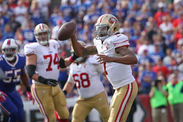Colin Kaepernick #7 of the San Francisco 49ers looks to throw against the Buffalo Bills during the first half at New Era Field on October 16, 2016 in Buffalo, New York. (Photo by Tom Szczerbowski/Getty Images)