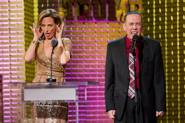 Marlee Matlin, left, and Gilbert Gottfried appear onstage at the Comedy Central Roast of Donald Trump in New York, Wednesday, March 9, 2011. (AP Photo/Charles Sykes)