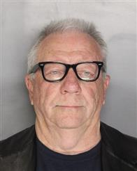 This undated photo provided by the Sacramento County Sheriff's office shows Michael Lacey. Lacey and two other operators of an international website, Backpage.com, that advertises escort services, said in court in Sacramento, Calif., Wednesday, Oct. 12, 2016, that they will challenge charges of trafficking prostitutes and pimping on First Amendment grounds. (Sacramento County Sheriff's Office via AP)
