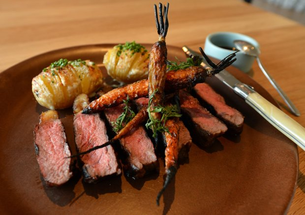 The grilled grass fed steak with carrots and potatoes awaits a diner in the Limewood Bar & Restaurant at the Claremont Hotel & Spa in Berkeley, Calif., on Monday, Oct. 17, 2016. (Kristopher Skinner/Bay Area News Group)