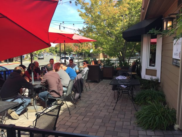 Relaxing on the patio sipping wine at the M4 Wine Tasting Room in Saratoga. Photo credit: Mary Orlin/Staff