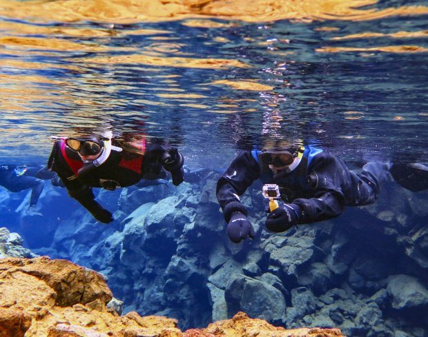 *ICELAND:* San Jose residents Jill, left, and Mike McCoy recently traveled to Iceland where they saw dramatic volcanic landscapes and geothermal pools, and snorkeled in the dramatic fissure between tectonic plates. (Courtesy of the McCoy family)