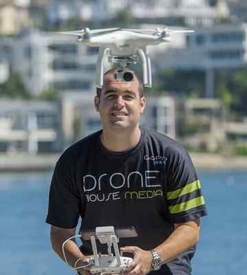Scott Kressin, 30, of Costa Mesa and owner of Drone House Media, flys a drone near a house in Newport Beach on Friday. Ken Steinhardt/Staff photographer