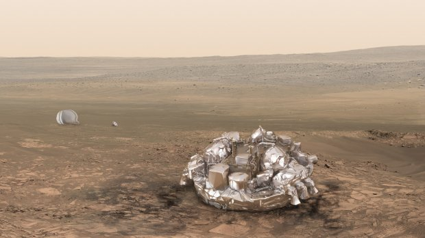 Artist impression of the Schiaparelli module on the surface of Mars provided by the European Space Agency, ESA. (ESA/ATG-medialab via AP)