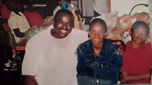 A young Amari Cooper is photographed at The Barnyard, an after-school program and summer camp in the Coconut Grove neighborhood of Miami along with his sister Ashley and counselor Travis Swain. (Photo courtesy of The Barnyard)