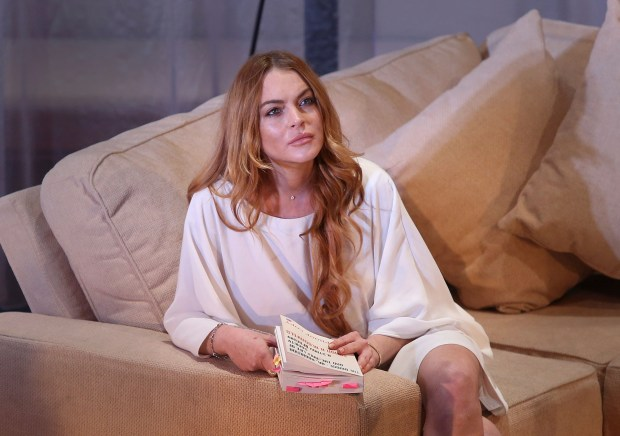 "FILE - In this Sept. 30, 2014, file photo, actress Lindsay Lohan performs a scene from the play, ""Speed the Plow,"" during a photocall at the Playhouse Theatre in central London. Lohan said on social media Sunday, Oct. 2, 2016, that she lost part of her finger in a boating accident. (Photo by Joel Ryan/Invision/AP, File)"