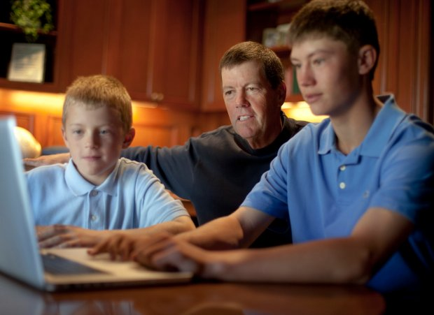 Scott McNealy with his sons, Scout, 8, left, and Maverick, 14, in their Portola Valley home Friday Aug. 20, 2010. McNealy is an ambitous guy who has taken on a number of ambitious quests. He's probably best know for being a founder and CEO of Sun Microsystems, a Silicon Valley company he ran for 26 years. That identity and his company both disappeared early this year after Oracle bought Sun. Now he's on to Curriki.org, a project to create a completely open-source, free and digital cirriculum for K-12 education. (Photo by Patrick Tehan/Mercury News)