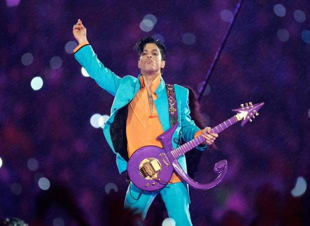 "FILE - In this Feb. 4, 2007 file photo, Prince performs during the halftime show at the Super Bowl XLI football game at Dolphin Stadium in Miami. For the first full sales week following Prince's death on April 21, 2016, five of his albums were in Billboard's top 10, at Nos. 2, 3, 4, 6 and 7. Only Beyonce's ""Lemonade"" kept him from the top. Billboard says no artist has had that many albums in the Top 10. (AP Photo/Chris O'Meara, File)"