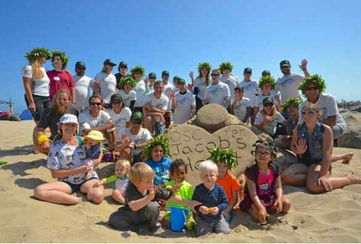 Children and their families from Jacob's Heart pose for a photo on the beach near Santa Cruz Small Craft Harbor following last year's journey from Half Moon Bay to Santa Cruz. (Jim Jackson Rahn Photography — Contributed)
