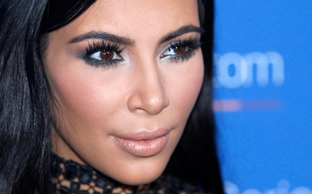 FILE - In this June 24, 2015, file photo, Kim Kardashian West poses during a photo call at the Cannes Lions 2015 in Cannes, France. Kardashian is taking some time off from sharing content on her for-pay phone app more than two weeks after she was held up at gunpoint in Paris, according to a handwritten noted posted there Monday by an assistant. (AP Photo/Lionel Cironneau, File)