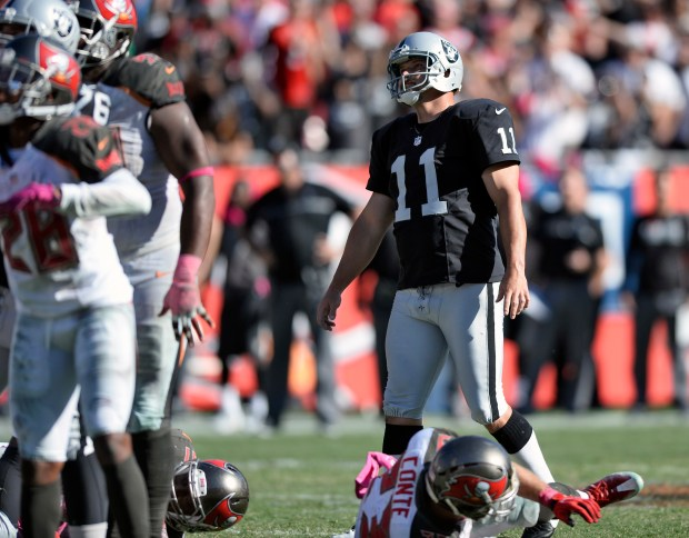 Oakland Raiders kicker Sebastian Janikowski (11) watches as his field goal against the Tampa Bay Buccaneers goes wide during the fourth quarter of an NFL football game Sunday, Oct. 30, 2016, in Tampa, Fla. (AP Photo/Jason Behnken)